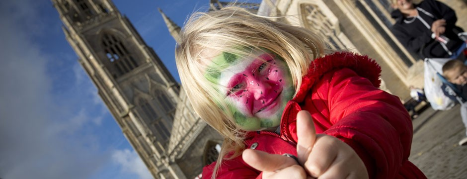 Small girl with face painted as a watermelon at the Festival of Fruit