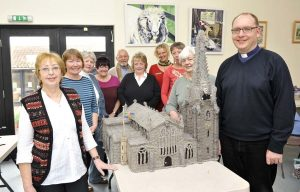 Spalding knitters and Reverand John Bennett with the woolly St Mary St Nicolas